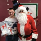Client standing with Santa in Adult Day Services.
