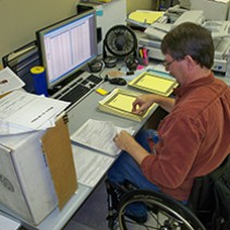 BTCO employee working in the document conversion department