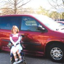 Equipment Fund Client outside wheelchair van
