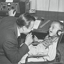 CPRF Founder Jack Jonas with an audiology client in the 1960s.