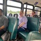 Adult Day Services clients are seated on Timber Lines bus after a community outing.