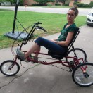 Client posing on her adaptive bike.