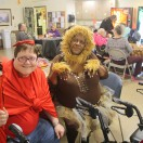 Two Timbers residents pose in their Halloween costumes at karaoke.