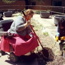 A Timbers residents working in their resident garden with the help of Wichita's local Horticulture Therapy Committee.