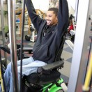 Client using wheelchair accessible weight lifting machine.