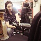 Technician working on joystick of powerchair.
