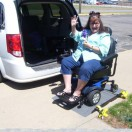 Equipment Fund Client outside of wheelchair van