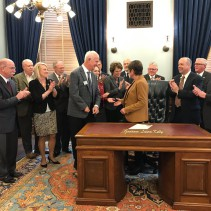 Gov. Laura Kelly and group at bill signing.