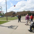 Adult Day Services clients playing basketball.