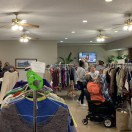 Timbers residents shopping at annual clothing market in congregate area.