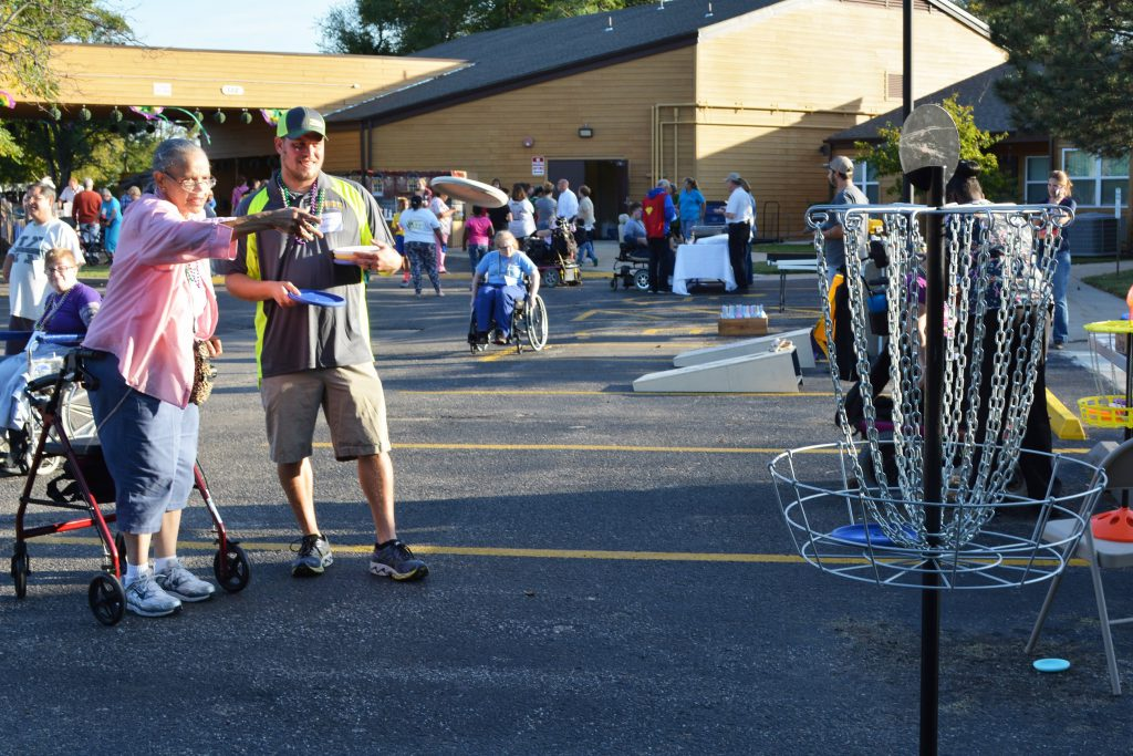 Volunteer Jehramy Heckman playing disc golf at Timbers Fest.