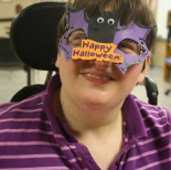 Adult Day Services client shows off her Halloween mask
