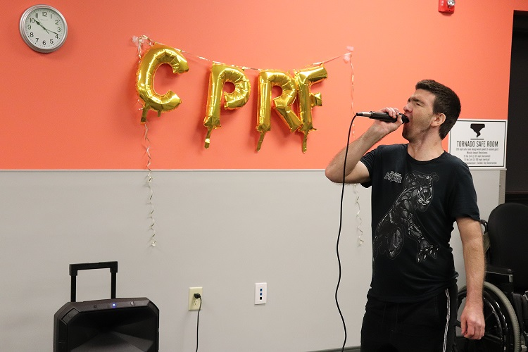 Adult Day Services client singing karaoke.