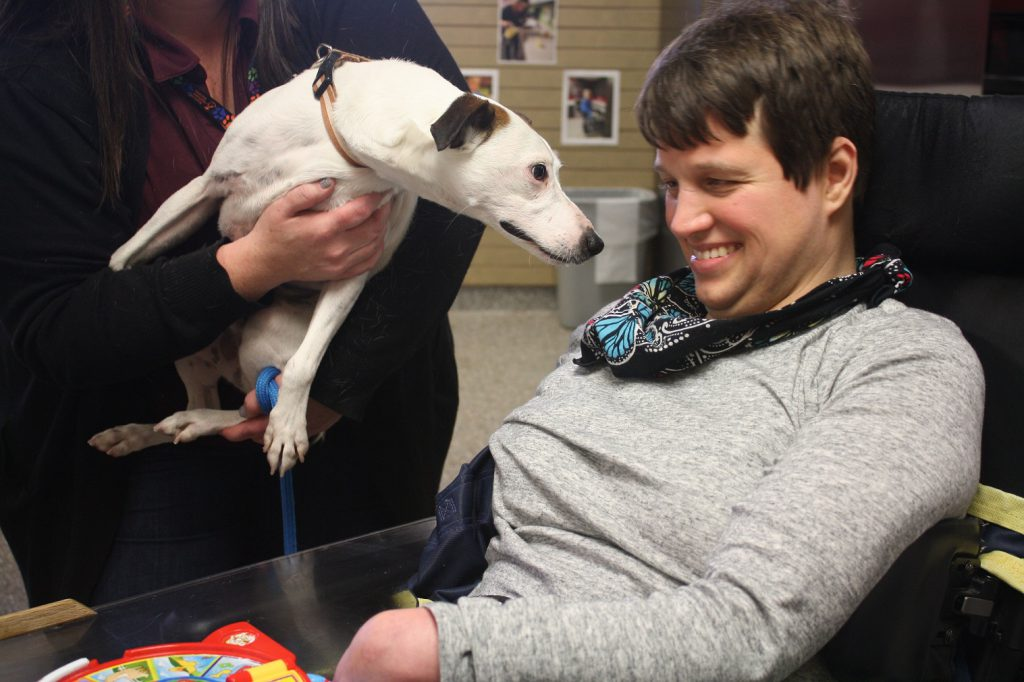 Deborah visiting with a dog from the Kansas Humane Society in our Adult Day Program.