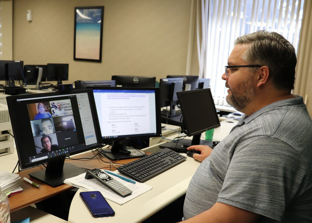 SACT instructor looking at students in virtual classroom on computer monitor.