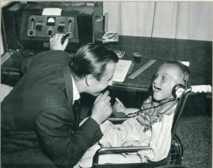 Jack Jonas with an audiology client in the late 1950s.